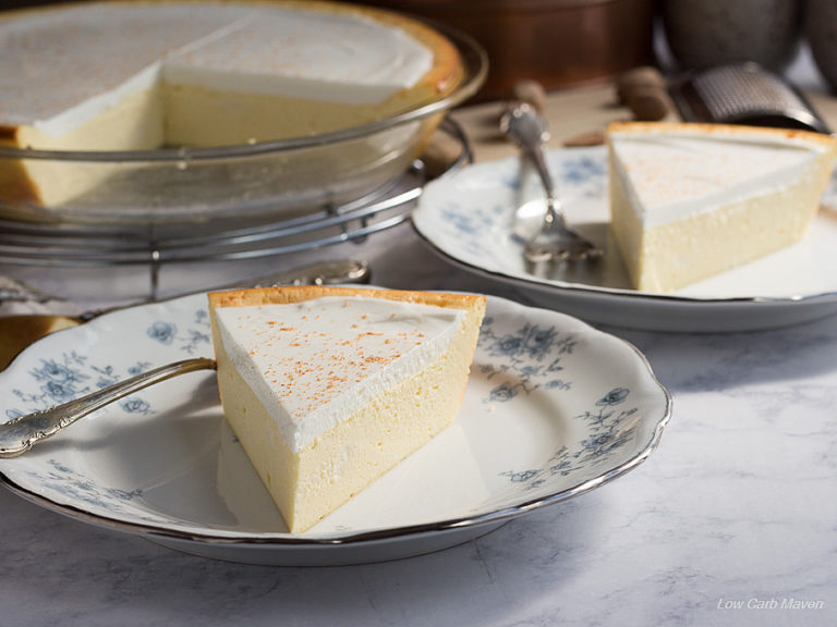 Slice of cheese pie or crustless cheesecake on a blue and white china plate.