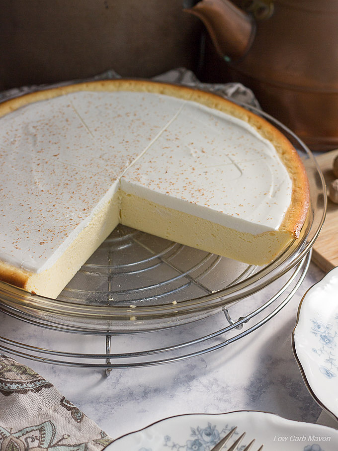 Cheese pie or crustless cheesecake with sour cream top in a pie plate.