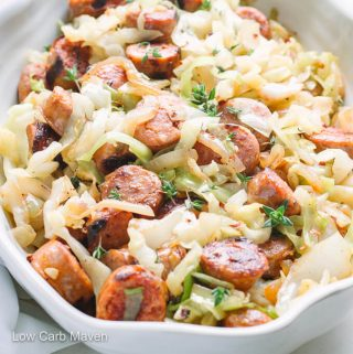 Cooked sliced sausage and cabbage in serving bowl.