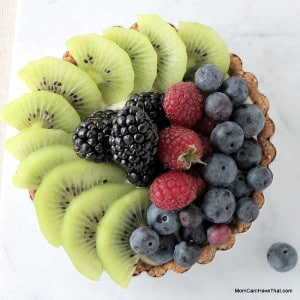 These Fresh Fruit Tarts are filled with coconut milk pastry cream and have a coconut-almond crust | Low carb, Gluten-free & Casein-free | lowcarbmaven.com