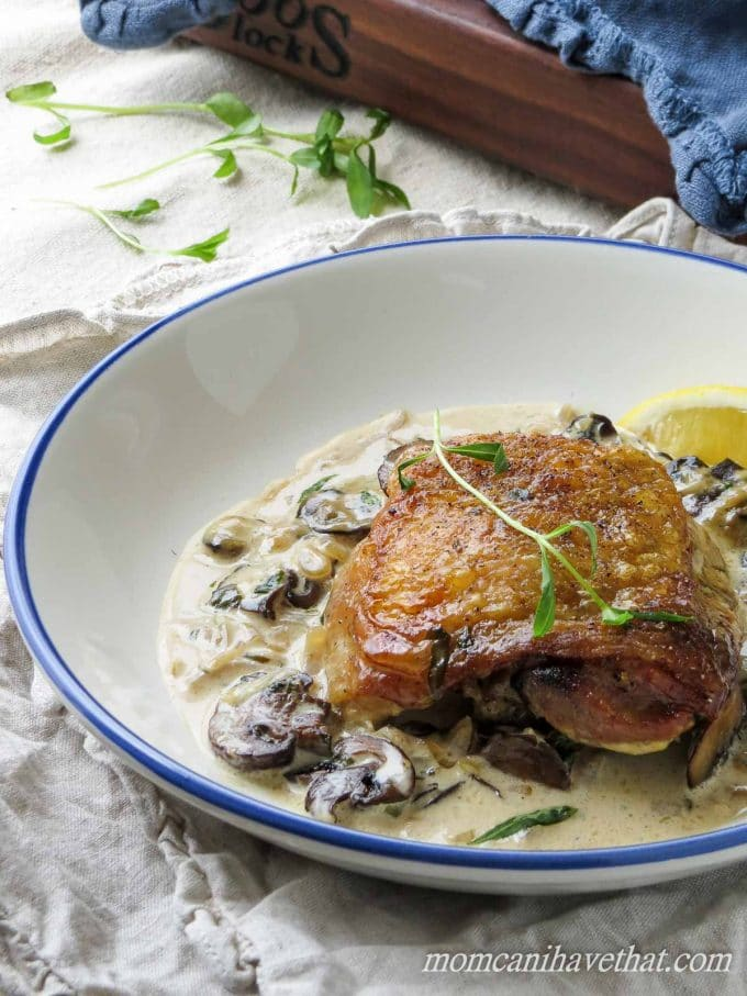 Chicken Thighs with Mushrooms and Tarragon Cream features golden chicken thighs in a white wine and cream sauce flavored with browned mushrooms and fresh tarragon. 7 net carbs per serving.