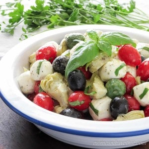 Caprese Salad with Olives & Marinated Artichoke Hearts is great for gatherings. | low carb, gluten-free, keto |lowcarbmaven.com