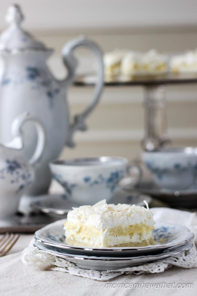 Low Carb Coconut Cream Layered Dessert (Coconut Cream Delight) with shortbread crust, cream cheese, coconut pudding, whipped cream and coconut.