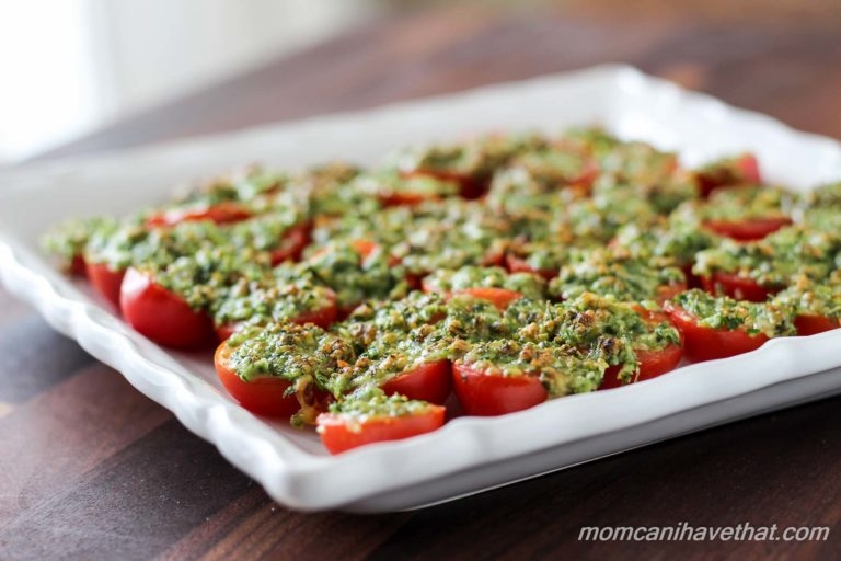 Baked parmesan tomatoes on a plate.