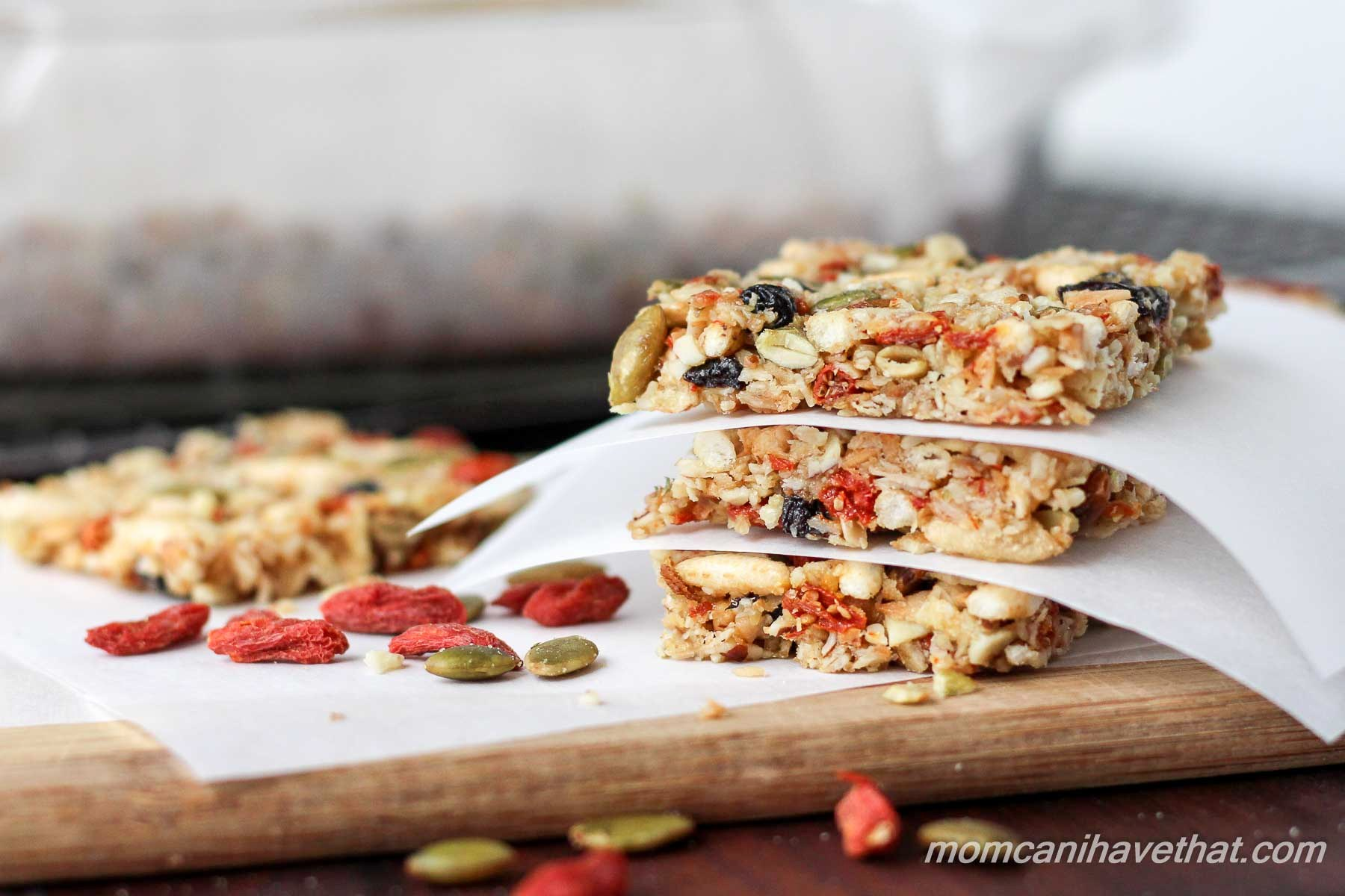 Gluten-free oats, nuts, & seeds make the base for these lightly - sweetened Kitchen Sink Bars healthy - currents, puffed rice & gogi berries make them fun.| gluten-free, dairy-free | MomCanIHaveThat.com