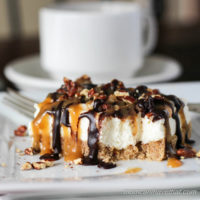 Pecan Turtle Cheesecake Bars have a brown sugar pecan crust & light-textured vanilla cheesecake topped with toasted pecans, chocolate fudge, & caramel. No-bake, low carb & sugar free | lowcarbmaven.com