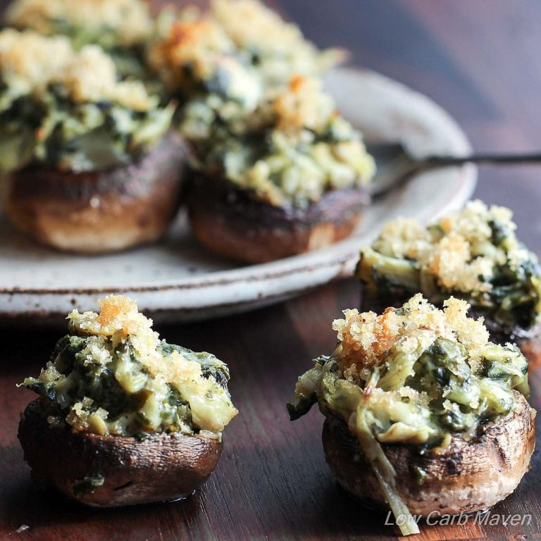 Two-Bite Spinach Artichoke Stuffed Mushrooms are the perfect party bite! | Low Carb, Gluten-free, Keto, THM | LowCarbMaven.com