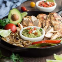 This authentic chicken fajitas recipe results in juicy and flavorful chicken and charred vegetables with minimal effort. Make it easy on yourself and buy the pico de gallo and guacamole from your favorite local taco shop to bring the whole meal together.   Low Carb, Gluten-free, Paleo, Whole 30