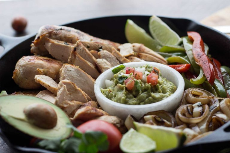 This authentic chicken fajitas recipe results in juicy and flavorful chicken and charred vegetables with minimal effort. Make it easy on yourself and buy the pico de gallo and guacamole from your favorite local taco shop to bring the whole meal together. | Low Carb, Gluten-free, Paleo, Whole 30