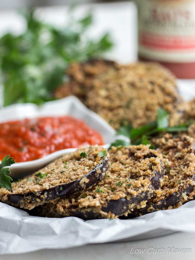 Crispy Fried Eggplant Rounds With Parmesan Cheese and Marinara Sauce make a great low carb snack.