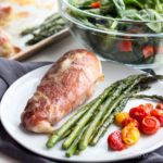 This Prosciutto Wrapped Sheet Pan Chicken dinner cooks in 30 minutes and is just 4 net carbs per serving. | low carb, gluten-free, primal, keto, lchf
