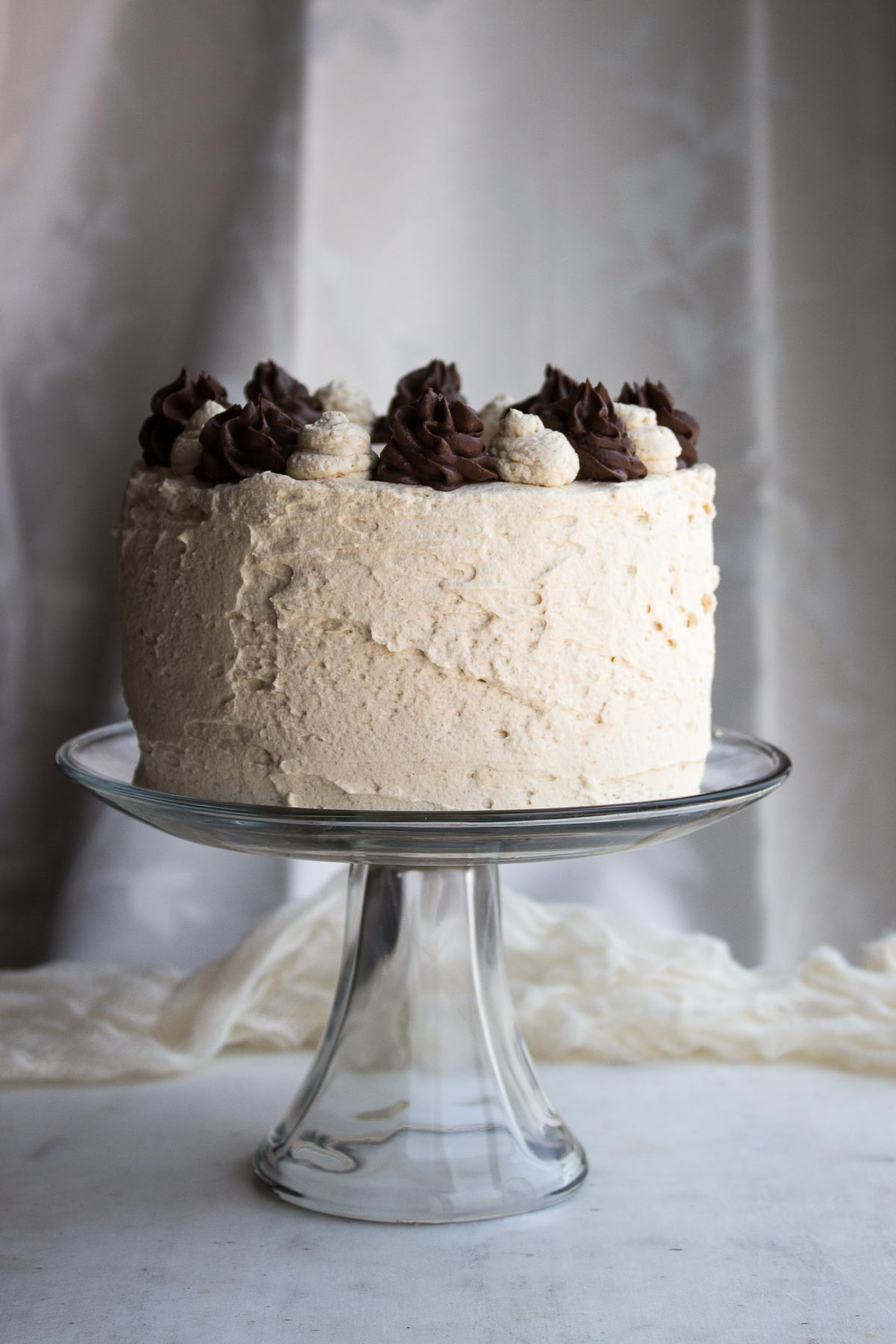 Super moist low carb peanut butter chocolate cake, filled with rich chocolate pastry cream & frosted with peanut butter whipped cream. low carb, gluten-free, keto, thm-h