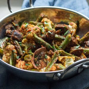 An easy side of cauliflower, green beans and mushrooms flavored with tomato and Indian spices. | low carb, gluten-free, dairy-free, paleo, whole 30