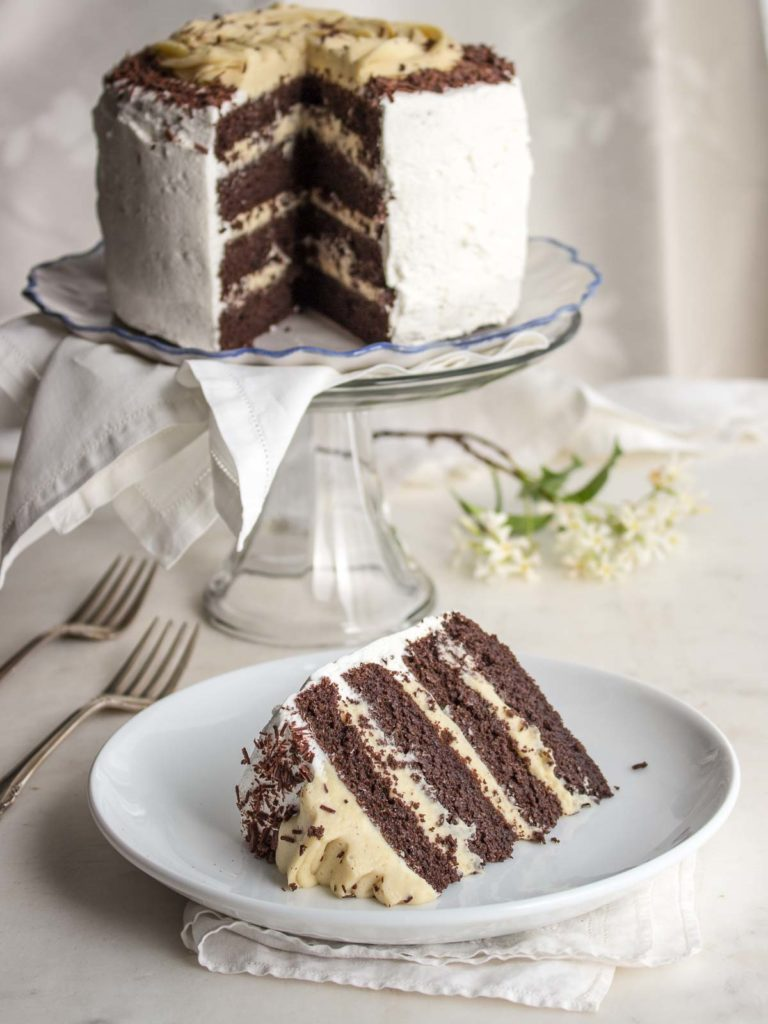 Low Carb Chocolate Layer Cake On A Stand With Slice Plate