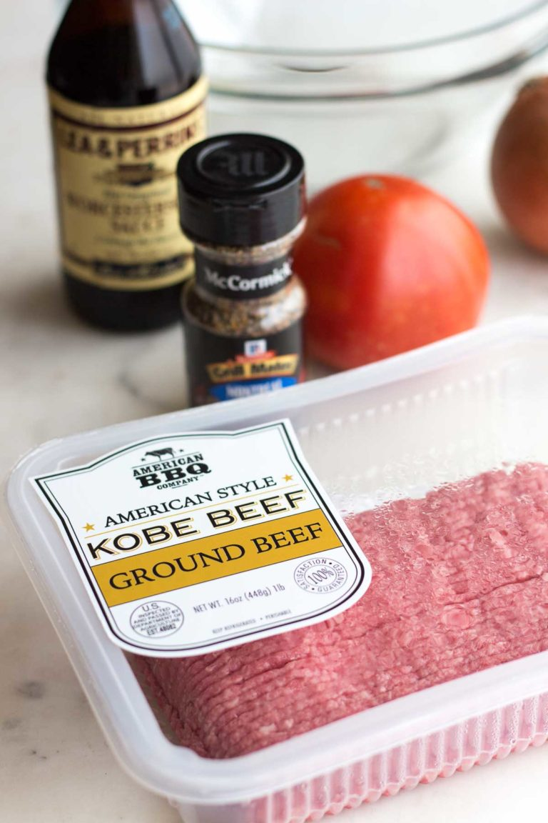 Ingredients for a low carb steakhouse burger: American style kobe ground beef, Worcestershire sauce, Montreal steak seasoning, and tomatoes.