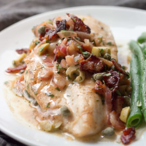 Pan seared chicken with a piquant sauce of bacon, caper, lemon, olives, and butter, shows low carb eating at it's best.