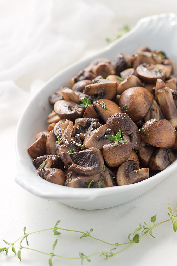 Easy Sauteed Mushrooms in white wine sauce with thyme is a quick weeknight side. #mushrooms #sauteed #white wine #sauce #easy #side #lowcarb #keto