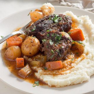 Low carb pot roast with vegetables in gravy served on cauliflower mash. keto, LCHF