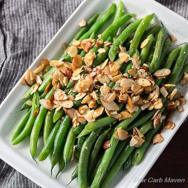 A low carb side of green beans almondine, cooked green beans, melted butter and toasted almonds.