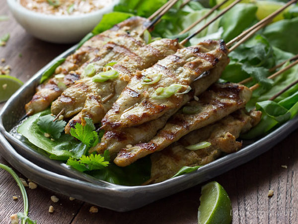 Easy thai chicken satay with peanut sauce low carb sugar free thai chicken satay marinated chicken threaded on bamboo skewers and grilled on a gray forumfinder Images