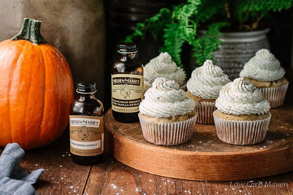 Pumpkin Spice Latte Cupcakes topped with whipped cream with Nielsen-Massey Vanilla and Coffee Extracts.