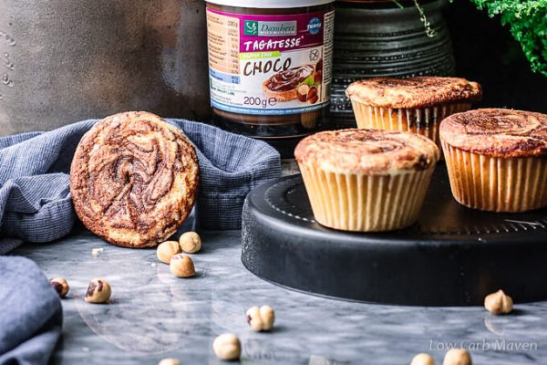Sugar-free nutella swirl muffins with sugar-free chocolate hazelnut spread and hazelnuts.