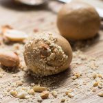 Low Carb Peanut Butter Balls (or peanut butter protein balls) rolled in chopped peanuts.