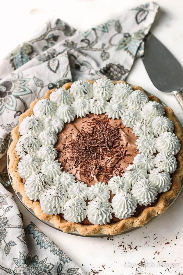 Sugar Free Chocolate Pie (French Silk Pie) with whipped cream and chocolate shavings is perfect for low carb diets.