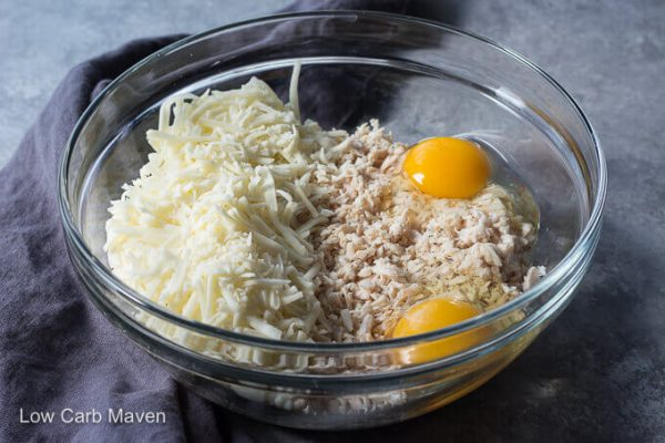 Chicken crust pizza ingredients in a bowl.
