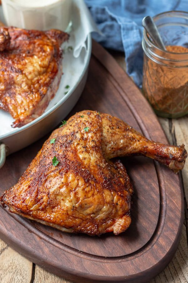 Smoked chicken leg quarters with sweet and spicy dry rub and Alabama white sauce. #trager