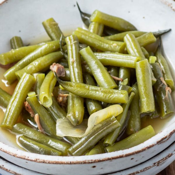 Southern green beans in a bowl with broth.