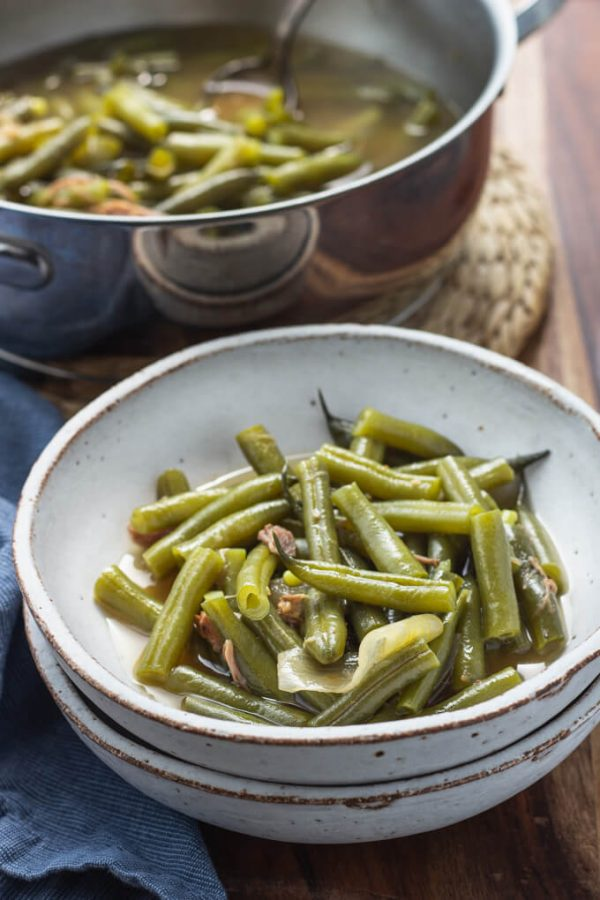 Southern green beans with pork and broth in a bowl.