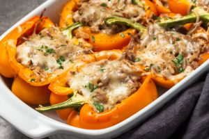pulled pork stuffed peppers in baking dish
