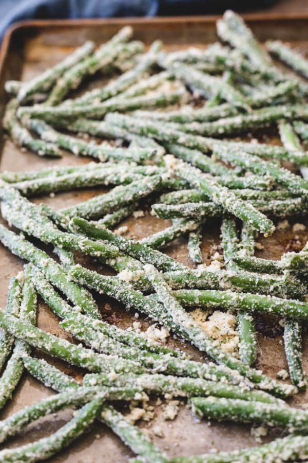 Garlic Parmesan green beans on a pan before cooking