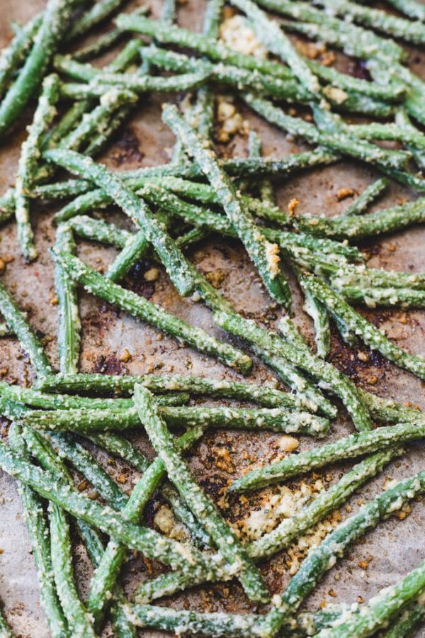Oven fried Parmesan green beans on a pan.