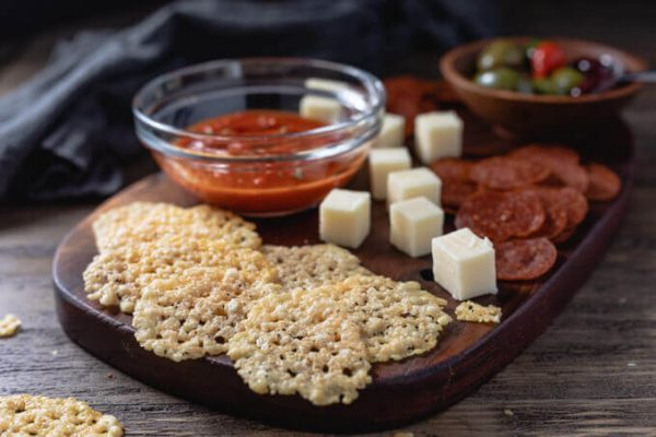 Parmesan crisps with marinara sauce, pepperoni chips and cubed cheese.