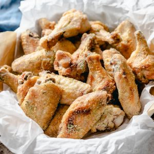 Tangy ranch chicken wings pieces in a basket.