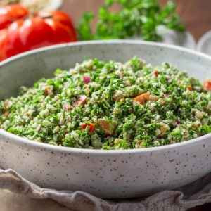 Cauliflower tabbouleh with tomatoes and parsley in a bowl