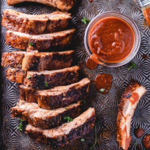 Keto oven baked ribs with BBQ sauce and drips