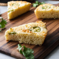Slice of keto cornbread with jalapenos on a cutting board