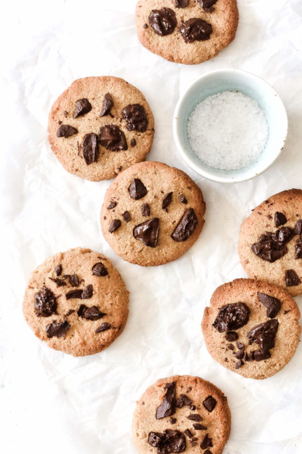 coconut flour chocolate chip cookies and a bowl of sea salt