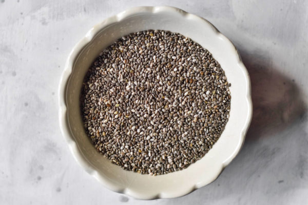 chia seeds in a scalloped white bowl.
