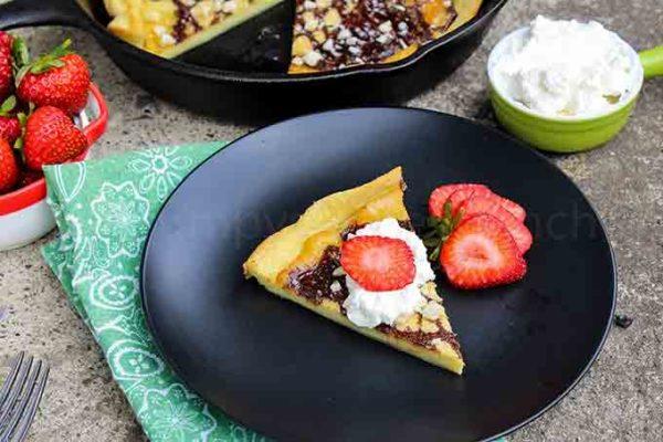 Low Carb skillet pancake slice on a black plate