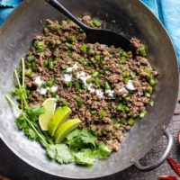 Keto green bean beef keema with yogurt, cilantro and limes in a wok
