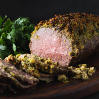 Sliced eye round roast beef with herb crust