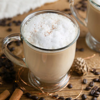 Low Carb Russian Coffee on wood with coffee beans, cinnamon sticks, and fuzzy white blanket