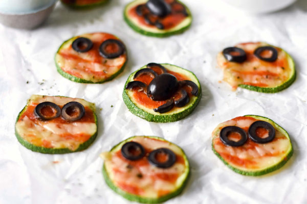 a side photograph of mini zucchini pizzas