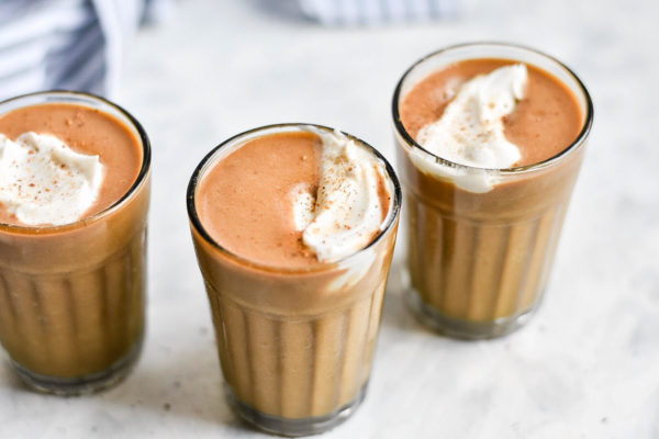 three pumpkin spice latte milkshakes in glasses