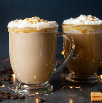 Sugar free coffee drink with whipped cream and caramel drizzle in a glass mug with handle