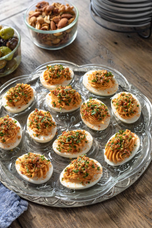Keto deviled eggs with bacon and chipotle on vintage egg platter